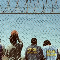 San Quentin Inmates Behind Fence. Photo Credit: Laura Kenmotsu