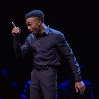 Giving Voice. Aaron Guy performing in the August Wilson Monologue Competition in New York, NY. c. Courtesy of Netflix © 2020